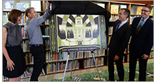 Cultural Affairs Manager Danielle Brazell, artist Shepard Fairey, Mayor Eric Garzelli, and City Librarian John F. Szabo unveil the new LAPL card design