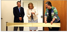 Principal Deputy Librarian of Congress Mark Sweeney (left) and Chief of Prints and Photographs Division Helena Zinkham (right) join Law Librarian of Congress Jane Sánchez as she cuts the ceremonial ribbon to open the Law Library's new secure storage facility on June 28. Photo by Donna Sokol